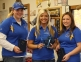 (L-R) Southeastern Illinois College students Ashley Evans from Harrisburg, Kailee Irvin from West Frankfort, and Tori Lewis from Galatia stand with their 2012 USIAC National Championship trophy in the women's bow hunter division. The national tournament was held over the weekend at University of Missouri in Columbia.
