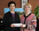Alexis Holmes of Harrisburg receives $50 check from Dr. Dana Keating, SIC vice president for academic and student affairs.