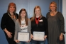 Two $500 scholarships were awarded following the 2013 Worldwide Youth in Science and Engineering (WYSE) academic competition held last month at Southeastern Illinois College.  Kate Thompson of Harrisburg High School, center left, and Katie Lawler of Gallatin County High School were chosen by the Southeastern Illinois College Foundation to receive the scholarships, as they scored the highest in their divisions during the competition.  Appearing with the students are Foundation board director Ayn Bartok, left, and Foundation board executive director Tricia Johnson.