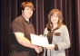 Alex Edwards of Eldorado accepts the Matthew J. Fry Memorial Scholarship from presenter Kim Martin.
