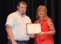 Sam Glenn of Galatia accepts the Dorothy Helen Baldwin Harrisburg BPW Scholarship from presenter Ayn Bartok.