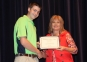 Patrick McKenzie of Carmi accepts the Rodney J . Brenner Memorial Scholarship from presenter Ayn Bartok.