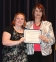 Sarah Evitts of Simpson accepts the Illinois Health Improvement Association Scholarship from presenter Amy Murphy.