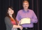 Emily Suh of Harrisburg accepts the Austin and Doris Welch Art Scholarship from presenter Allan Kimball.