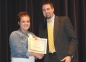 Hannah Cockrum of Galatia accepts the Mary Jo Oldham Female Student Athlete Award from presenter Chad Flannery.