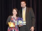 Bethany Oxford of Norris City accepts the Spirit of Southeastern Award from presenter Chad Flannery.