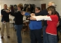 SIC instructor Kerry Jones assists Lynda Schutt of Elizabethtown (far right) with proper handgun handling during an intruder drill, as part of the Illinois Concealed Carry course held at the Harrisburg Hunters' Club on Nov. 14. Karen Wood-Belford (left) of Junction and Kim Bryant of Norris City participated in the drill as instructor, Dwight Howton observes.