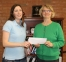 Kendall Seacrist of Norris City (left) receives $50 check from Dr. Dana Keating, SIC Vice President for Academic and Student Affairs, for winning the 2014 Paul Simon Essay Contest at Southeastern Illinois College.