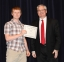 Kyle Wise of Eddyville was awarded the Rodney J. Brenner Scholarship by David Port, SIC Foundation Chair.