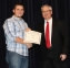 Luke Marsh of Norris City accepted the Eldorado Women's Club Scholarship from David Port, SIC Foundation Chair.