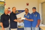 Kerry Jones and Dwight Howton of SI Bow Hunters Inc. present SIC Archery Team coaches Roger Snodgrass and Archie Blair with a donation to help with travel costs for the 2014-15 school year.