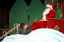 Jonah McGuire of Harrisburg, as Ralphie, rehearses an iconic scene with Santa in the upcoming production of A Christmas Story the Musical at Southeastern Illinois College.