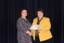 Callie Smith of Eldorado accepted an award from Dr. Karen Weiss, SIC vice president, during Honors Night for being the first student in SIC history to win the state award for the Paul Simon Essay Contest, besting all other college student entries in Illinois.