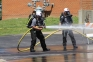 The Foresight Energy South team from Macedonia handles the hose competition at SIC during last year's mine competition.  The team took first place on day two.
