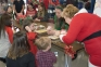 Southeastern Illinois College Nursing students and faculty help children make the perfect treat for Santa's reindeer during SIC's Breakfast with Santa.