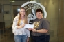 Olivia Matthews of Cave-In-Rock (left) receives a $50 check from Dr. Karen Weiss, SIC Vice President of Academic Affairs, for winning the 2018 Paul Simon Essay Contest at Southeastern Illinois College.