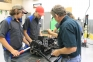 Instructor Ralph Boots walks students through the process of inspection and disassembly of a two-cycle engine during an SIC PowerSports class.