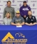 Kahok trap shooter Elijah Norton signs to become an SIC Falcon next year. Pictured (front row, l-r) are mother Michele Norton, Elijah Norton, and SIC head coach Jordan Hammersley.  Back row is father Mason Norton and Collinsville Kahok trap coach Chris Bossetto.